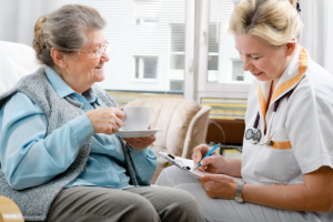 caregiver talking to her senior patient